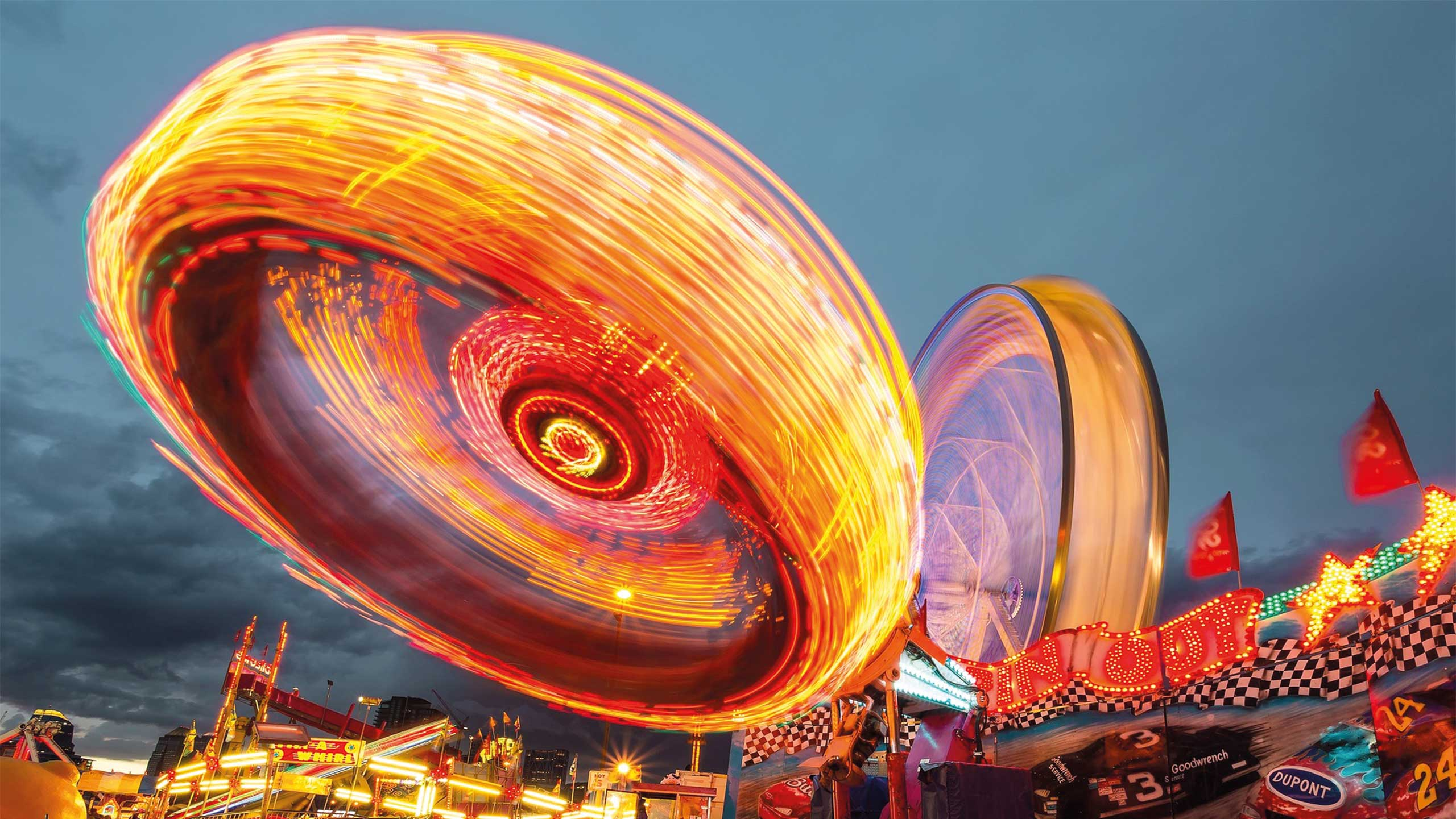photo of spinning ride during the evening with lights