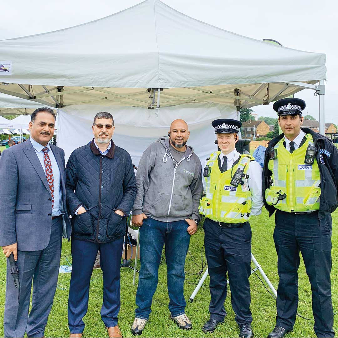 photo with Luton Councillor Aslam, Inspire FM director Zaffar, Station Operations Manager at Inspire FM Mohammed Tariq, and memebers of the Police Community Cohesion Team