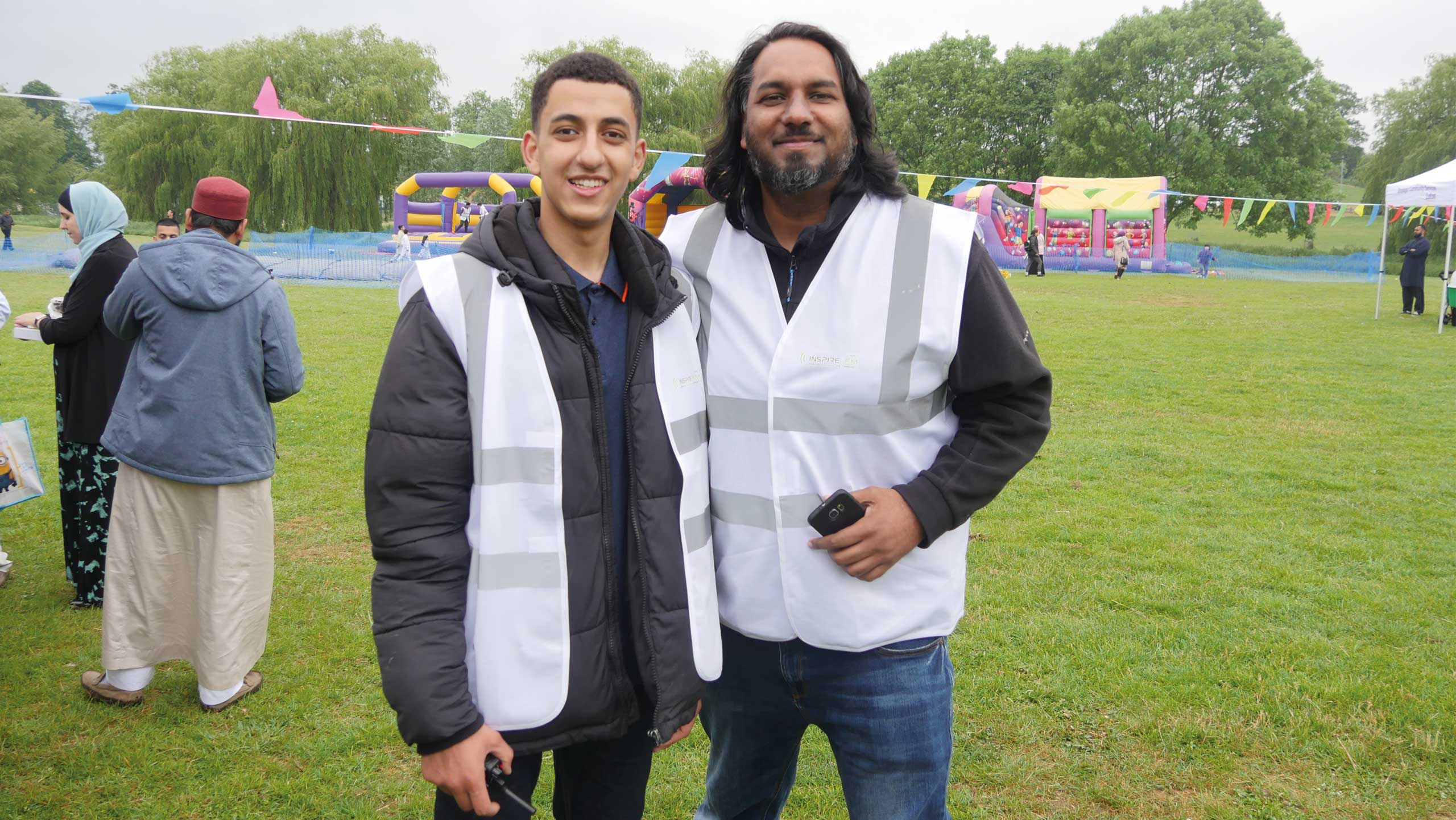 photo from Inspire Eid in June with two volunteers smiling