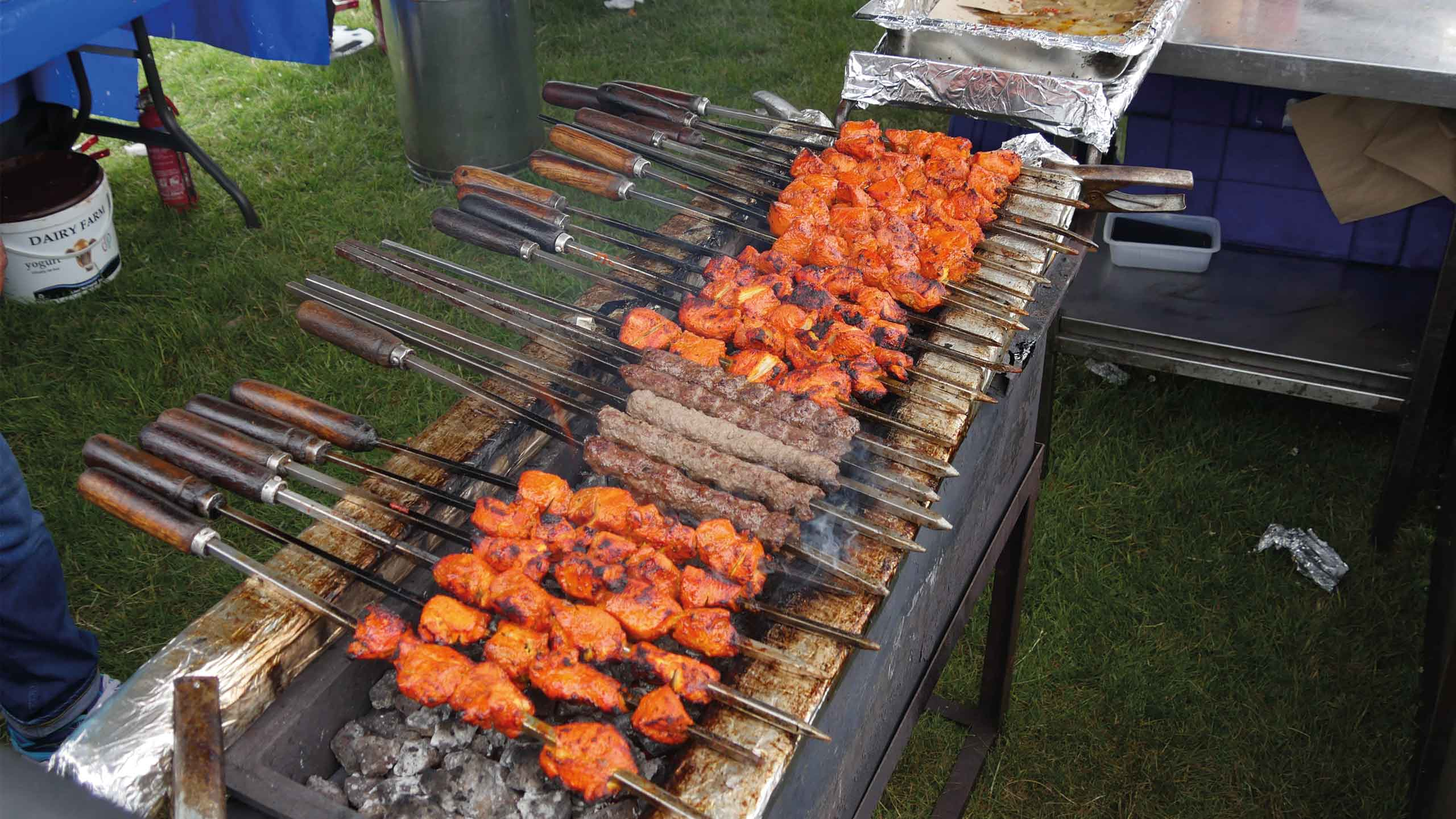 photo ob chicken and lamb kebbabs on bbq grill at Inspire Eid event